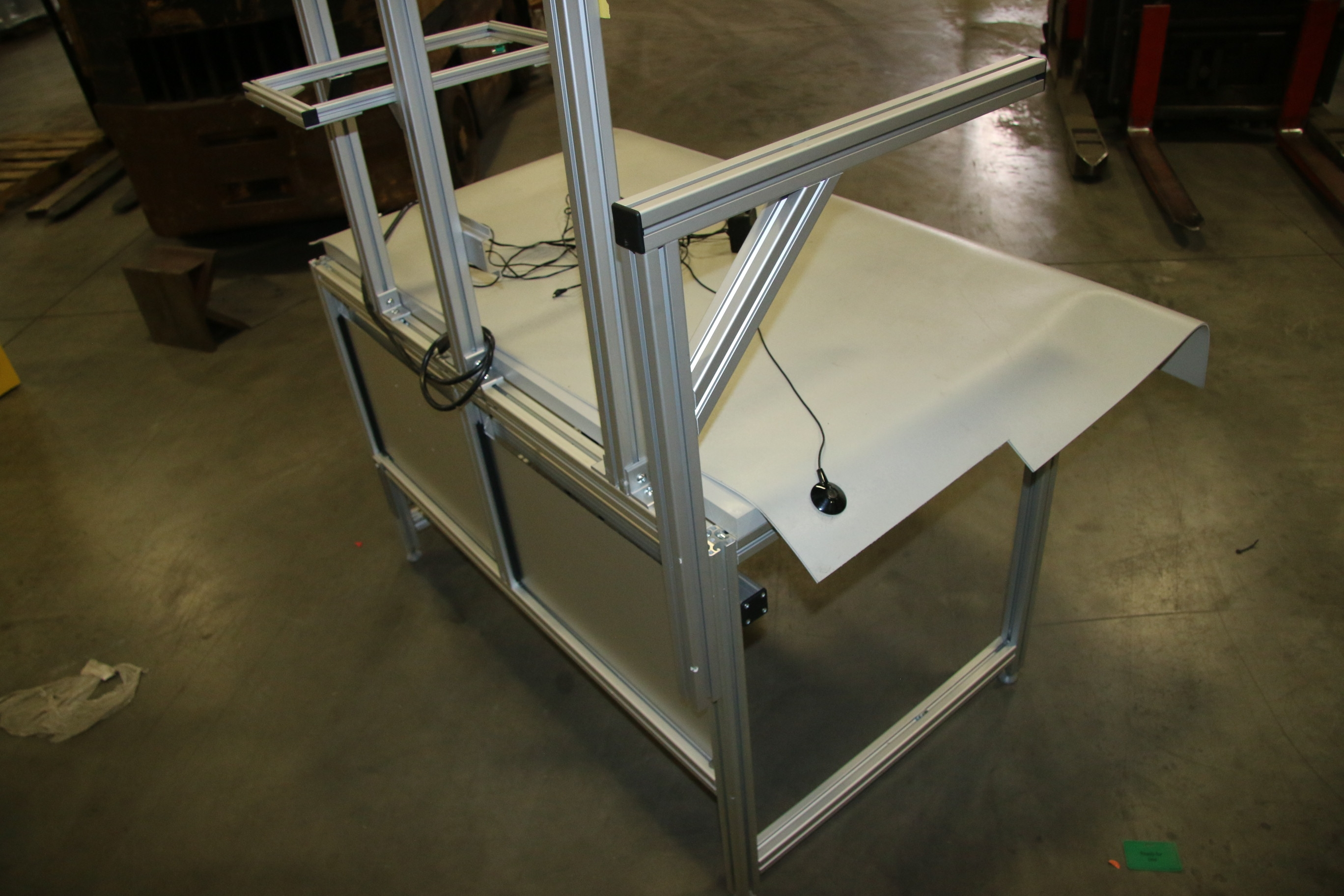 Used 80/20 T-Slotted Aluminum Frame 48″ x 31″ x 32″ Custom Work Bench 17490