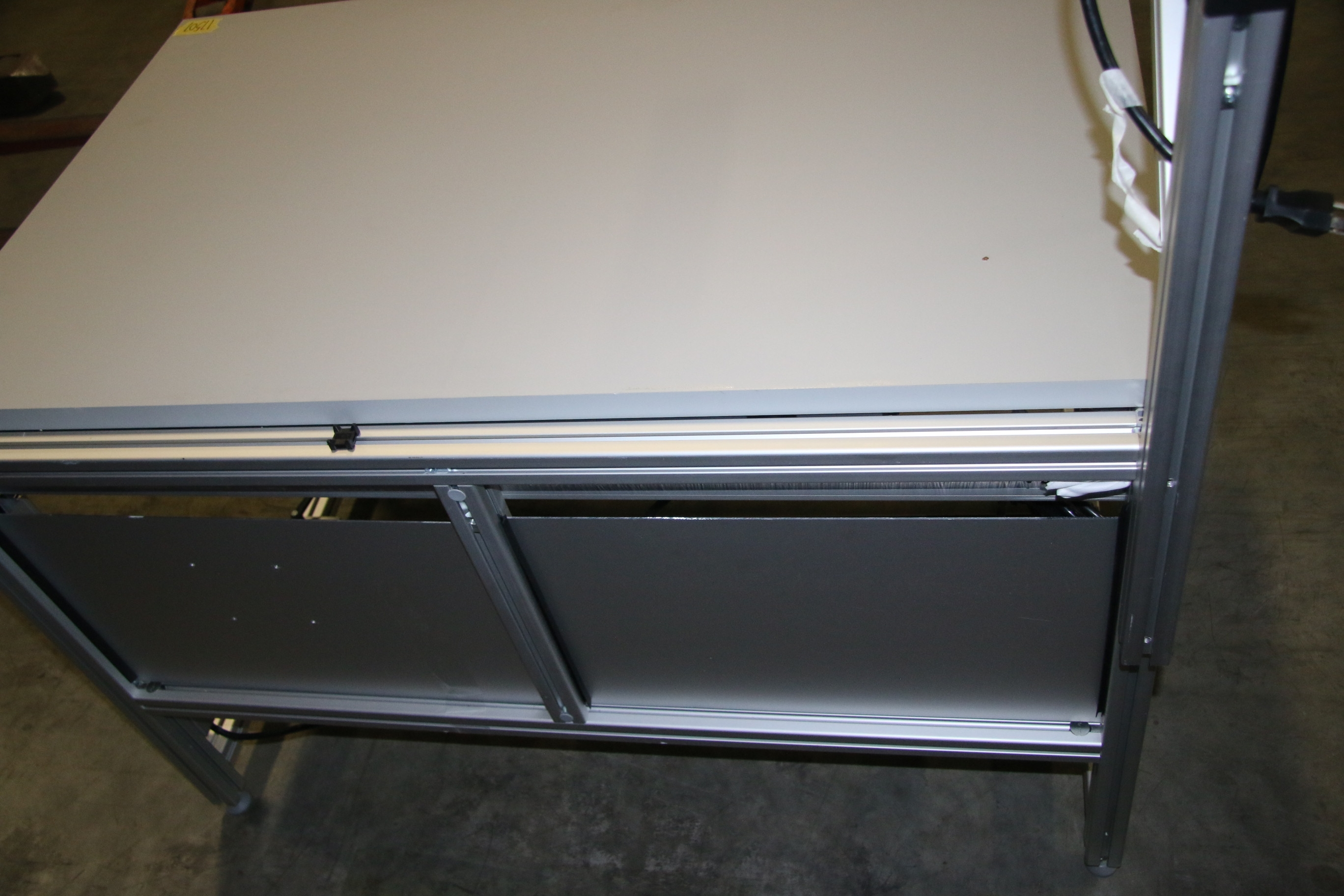 Used 80/20 T-Slotted Aluminum Frame 48″ x 31″ x 36″ Custom Work Bench 17507