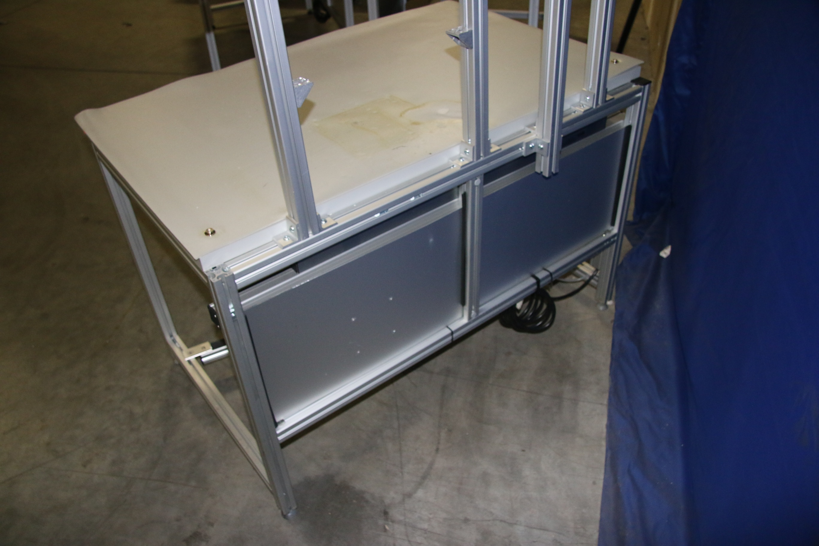 Used 80/20 T-Slotted Aluminum Frame 48″ x 31″ x 36″ Custom Work Bench 17509